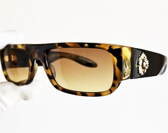 e504da67b94a VERSACE vintage Sunglasses rare black oval gold lion frame Gianni VERSUS  E02 supreme square rectangular 90s new brown yellow lens Migos wrap