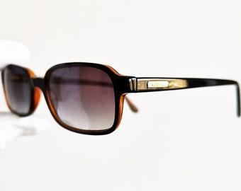 VERSACE lunettes de soleil vintage rares noir rectangulaire carré orange  Gianni 3001 suprême petit cadre ovale fait dans nouvelles lentilles de  medusa ... 3891ec9c6b2
