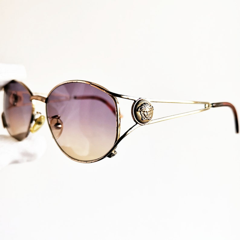 e2632bbdef106 VERSACE vintage sunglasses rare oval mask gold rim medusa