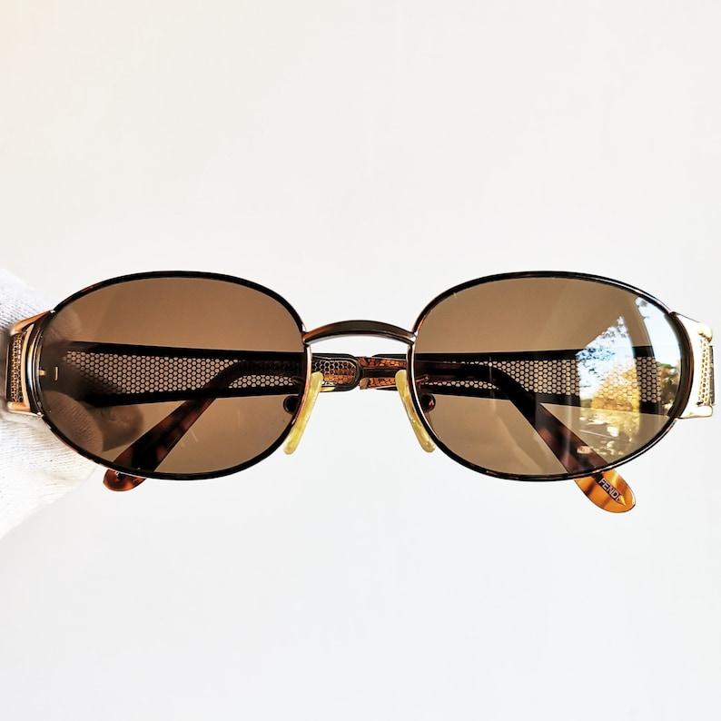 5a64c959f2 FENDI vintage sunglasses rare oval gold grid bars temples