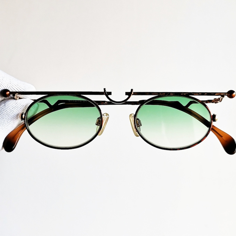 03b55eef8a8b1 Vintage Sunglasses rare oval designer frame steampunk 90s supreme strange  shape space age Sabahn small tiny odd new green flat lens hype NOS