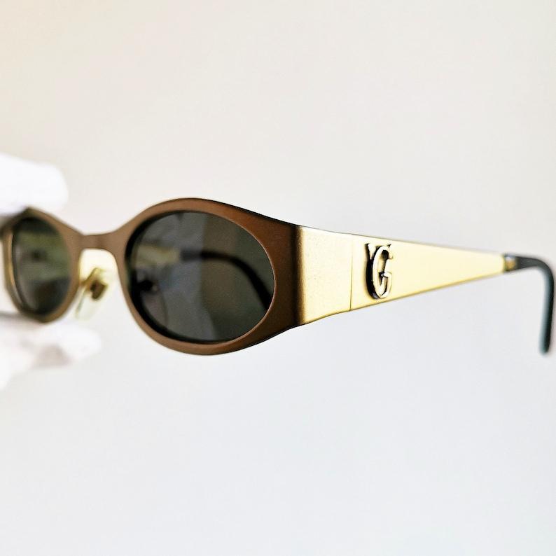 91f42bb132e5d VERSACE vintage Sunglasses rare matte satin gold oval S99
