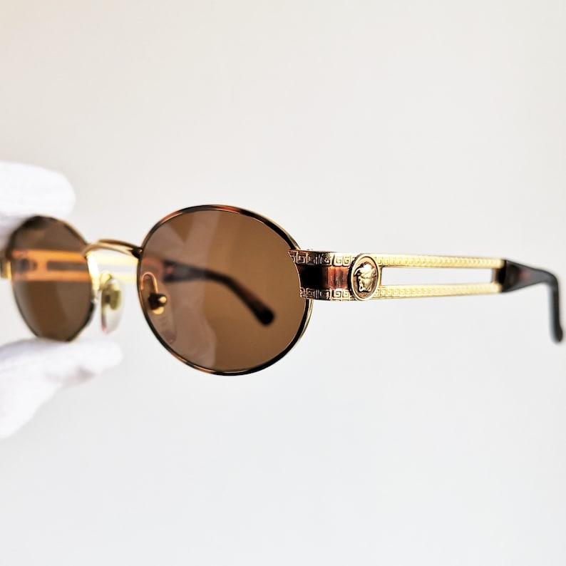 e3d1213fd25b VERSACE vintage sunglasses rare gold oval medusa temples greek | Etsy