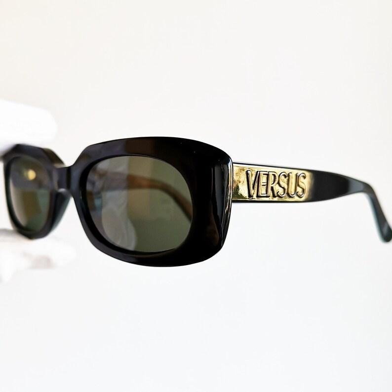 bb3eb7fea8559 VERSACE vintage Sunglasses rare black oval genuine frame