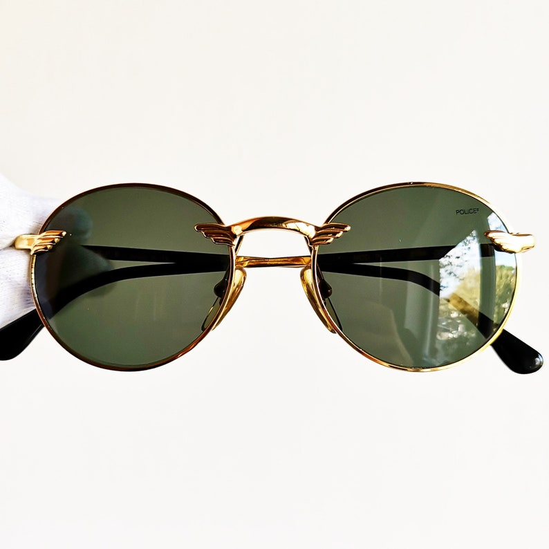 ee79b4349a4 POLICE vintage Sunglasses rare round oval engraved gold frame