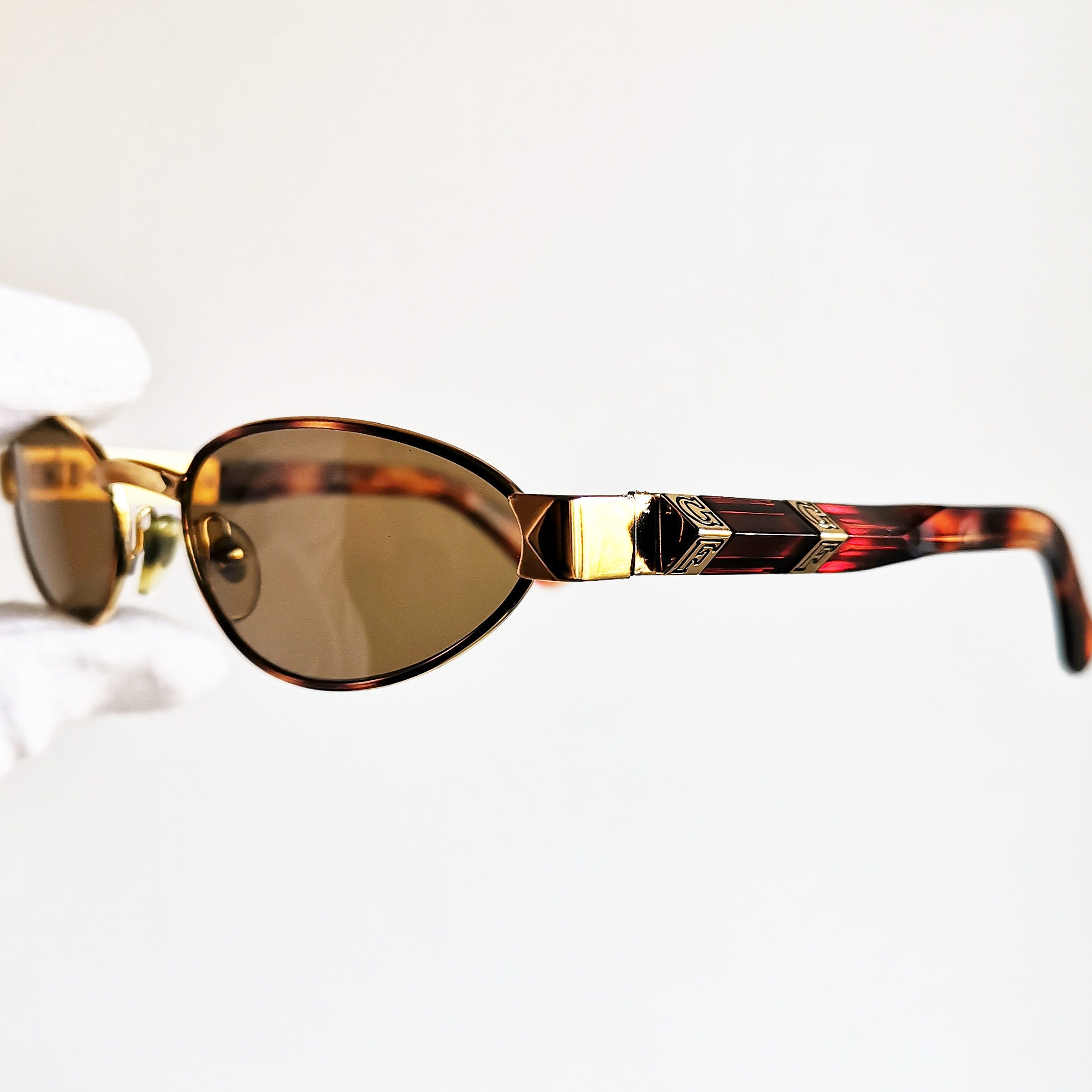 b4d07124f17b6 FERRE vintage SUNGLASSES rare oval gold arms rim temples