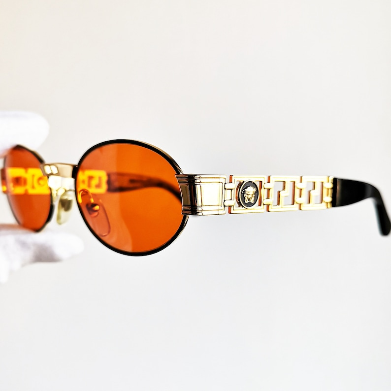 8b2f404af10 VERSACE vintage sunglasses rare black oval gold rim medusa genuine Gianni  S43 small custom frame steampunk new orange lenses NOS