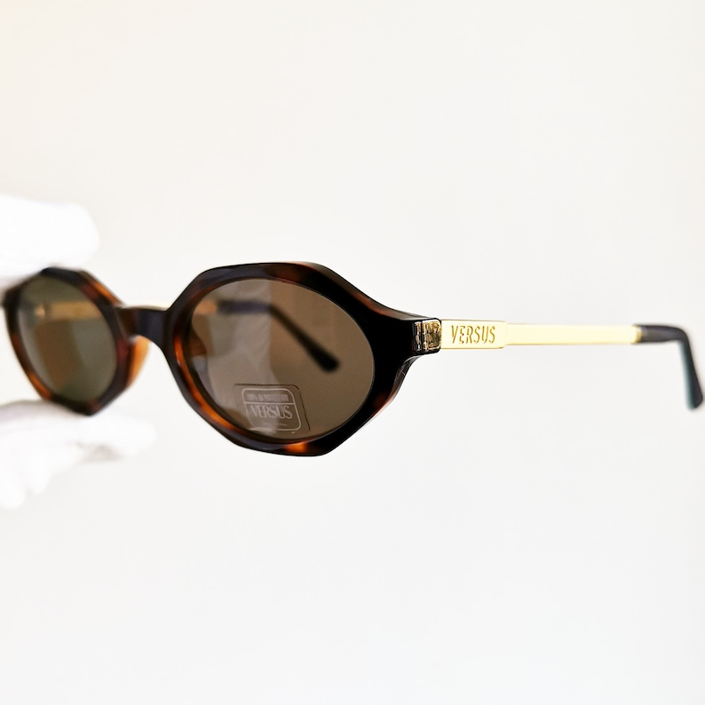 627ee121618dc VERSACE vintage sunglasses small hexagon oval gold rim arms