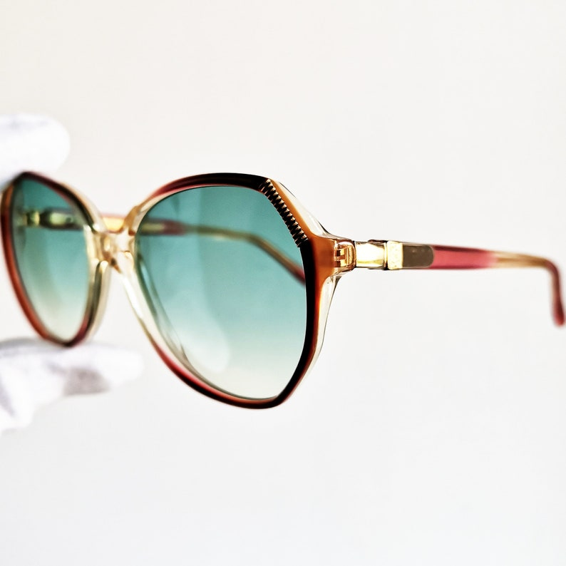 35972ec3196 YVES SAINT LAURENT vintage Sunglasses rare gold oval red clear