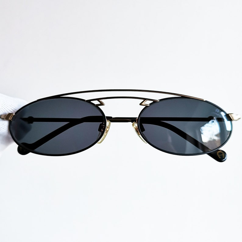 ee0017a4f7b ETIENNE AIGNER vintage sunglasses rare oval black gold space