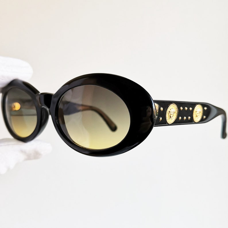 137730119a2 VERSACE vintage sunglasses rare oval black wrap mask gold