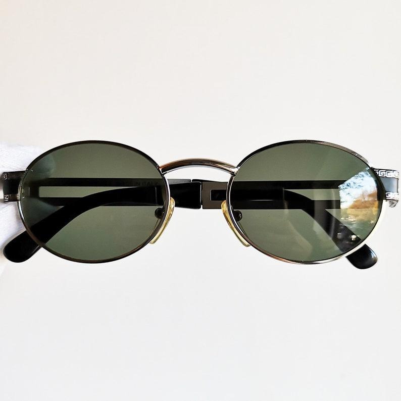 eaf63c97d4391 VERSACE vintage sunglasses rare black oval mask silver temples