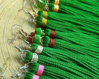Green tassels wrapped in an accent color