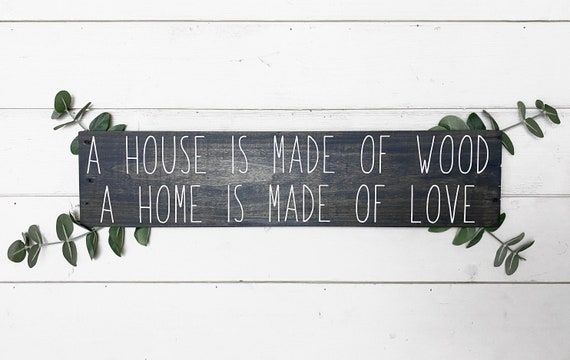A house is made of wood a home is made of love