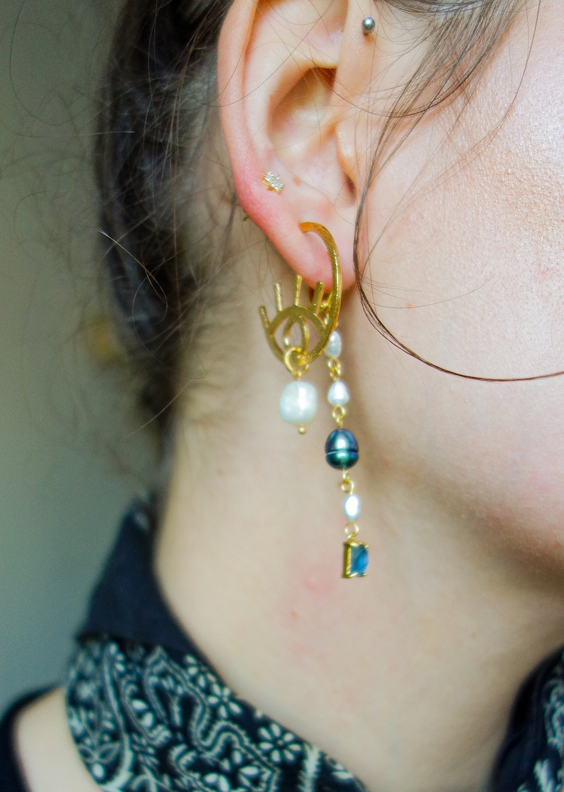 graphic Paloma evil eye style modern 24k gold plated earrings with freshwater pearl drops