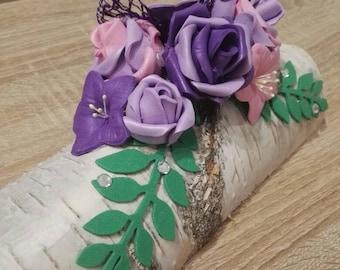 Flower arrangement on birch