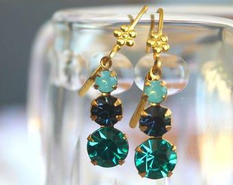 Beautiful Pacific Green Opal, Montana Blue and Blue Zircon Swarovski crystal dangle earings.