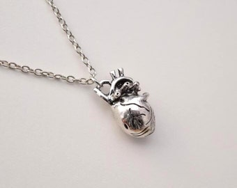 antique silver anatomical human heart necklace