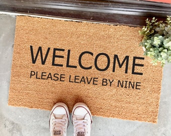 "welcome please leave by nine - 18x30"" doormat - cute doormat - porch decor - entryway decor - gifts for introverts - the cheeky doormat"