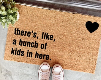 there's like a bunch of kids in here doormat - cute mat - welcome mat - gifts for moms - funny doormat - lots of kids - big family - cheeky