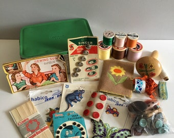 Vintage sewing kit in Sandwich tin.