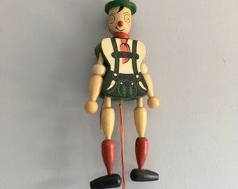 Vintage wooden Pinocchio puppet, measures 8 inches tall.