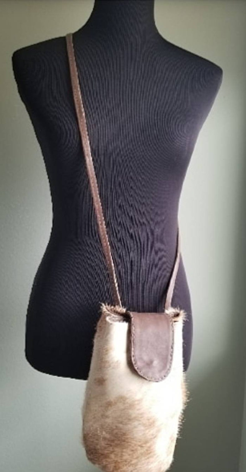 3 colors to choose from. Pouch Style Leather Bag