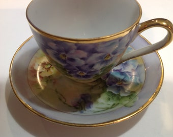 Tea Cup and Saucer in Blue and Purple Pansy Pattern