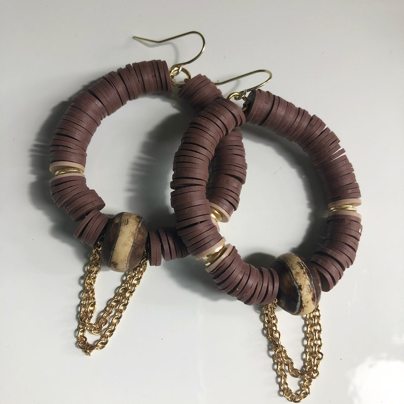 Brown beaded earrings with chain accents
