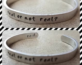Real Or Not Real? Real. - Hand Stamped Aluminum Cuff Bracelet - Custom - Unique - Hunger Games - Peeta Katniss - Quote - Creative - Hidden
