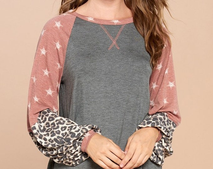 Solid knit top with star and cheetah printed sleeves