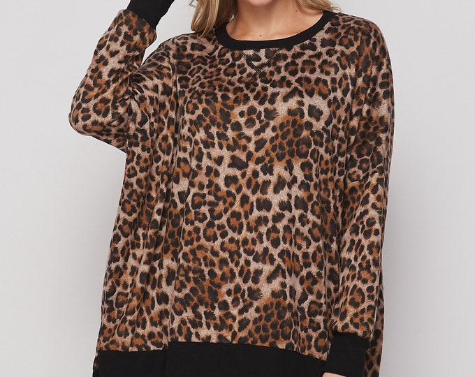 Cheetah print oversized top with black trim