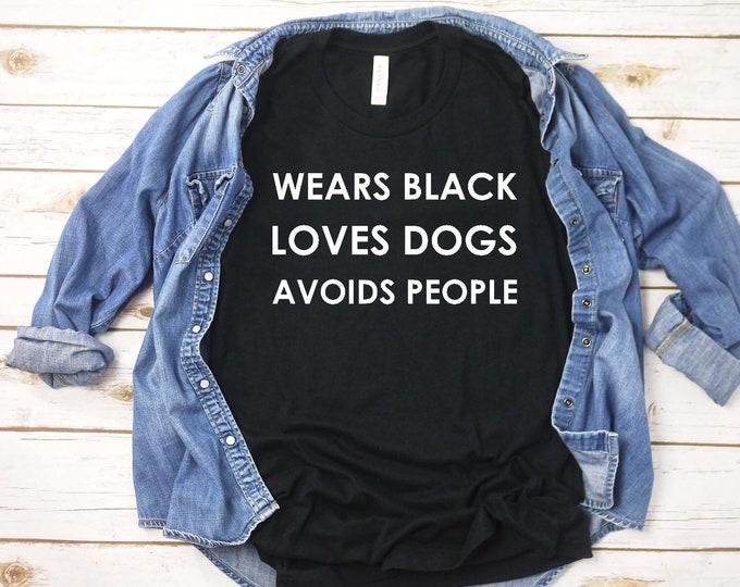 Wears black, loves dogs, avoids people