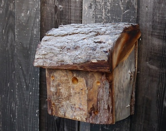 Birdhouse handmade from reclaimed larch