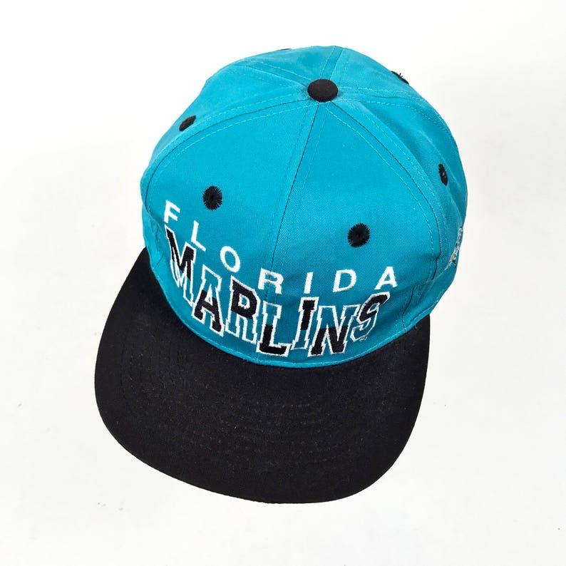 7fe983a4a86866 90s Florida Marlins Snapback Cap. Vintage MLB Baseball Florida Marlins Teal  Blac... 90s Florida Marlins Snapback Cap. Vintage MLB Baseball Florida  Marlins ...