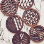 Laser cut laser engraved geometric wooden coasters in oak