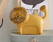 Handmade Ceramic Lion Money Box, designed in the UK by Hannah Turner. Get saving in style with this retro Lion Money Bank