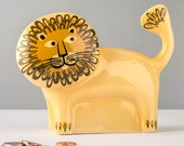 Lion Money Bank, designed in the UK by Hannah Turner. Get saving in style with this retro handmade ceramic retro Lion Money Piggy Bank