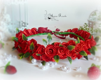 Wreath of Red Roses on the head.