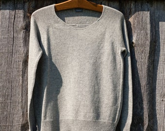 EXQUISITE KNITWEAR made of 100% natural WOOL and door