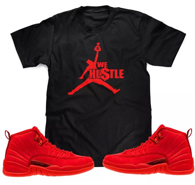 brand new 13b80 dc5b3 We Hustle T-Shirt To Match The Red Air Jordan Retro 12 BULLS Gym Red  Sneakers (S-3XL)