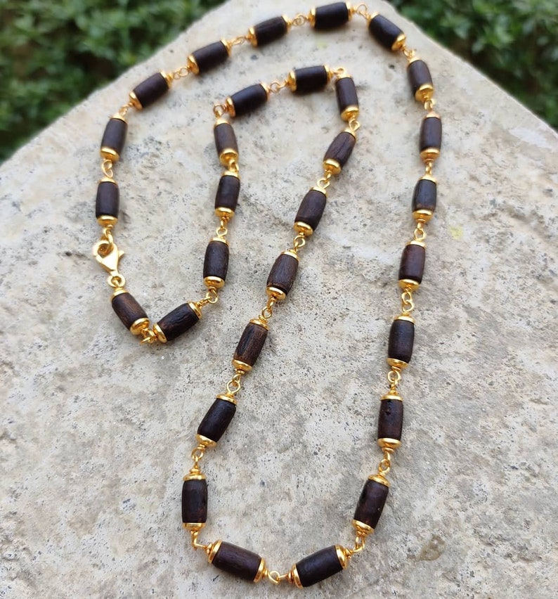 Golden barrel style tulasi beaded necklace