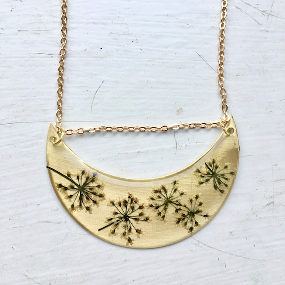 Queen Anne's lace flower brass crescent necklace