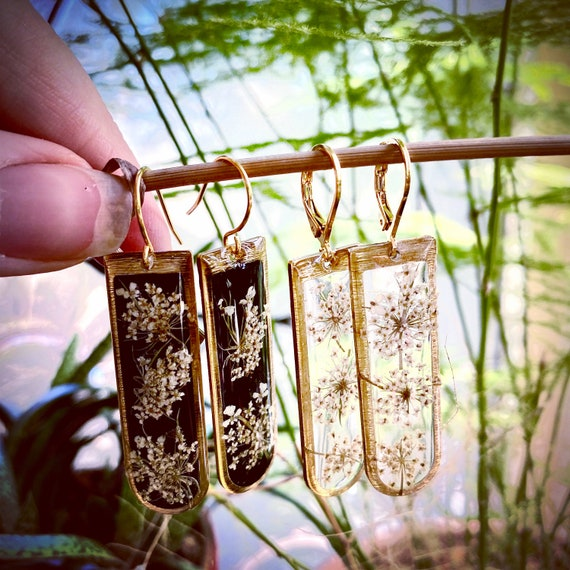 "Poison hemlock gold ""D"" dangly earrings"