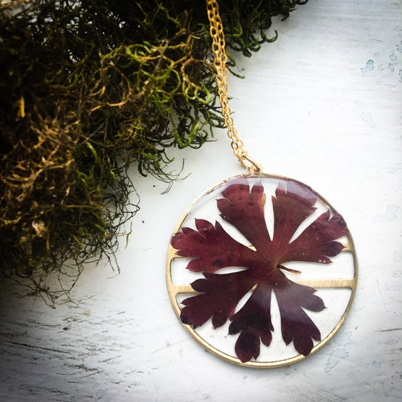 Wild geranium circle brass necklace