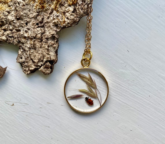 Wild grass seed and real ladybug gold circle necklace