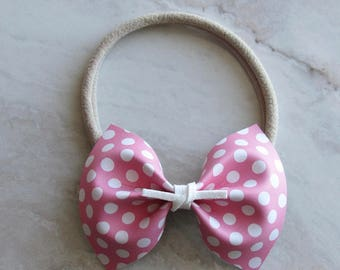Pink and white polka dot leather bow