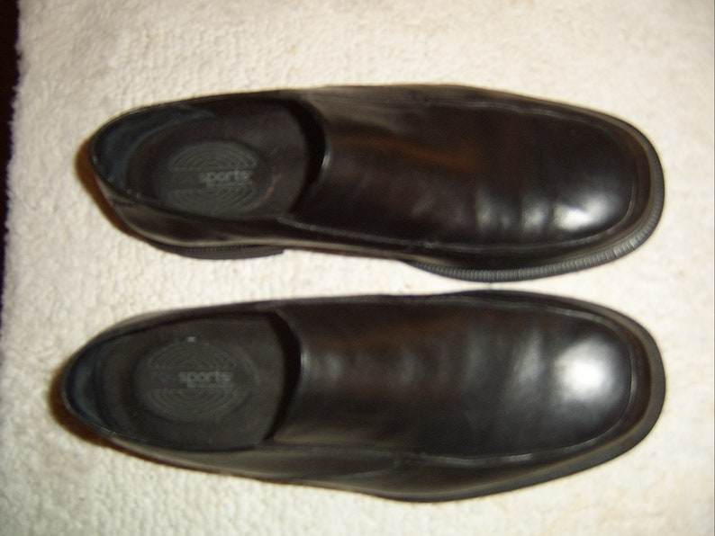 5e3d9f4aa534e Rockport RocSports Black smooth leather slip-ons/loafers
