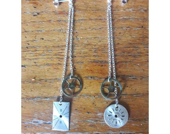 Earrings in silver, brass and watch face