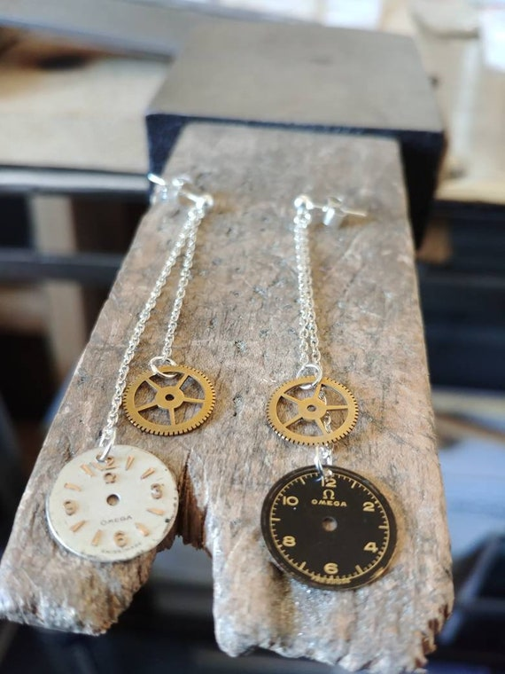 Earrings in silver, brass and Omega watch face